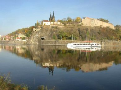 Vysehrad_as_seen_over_the_Vltava_from_Cisarska_louka